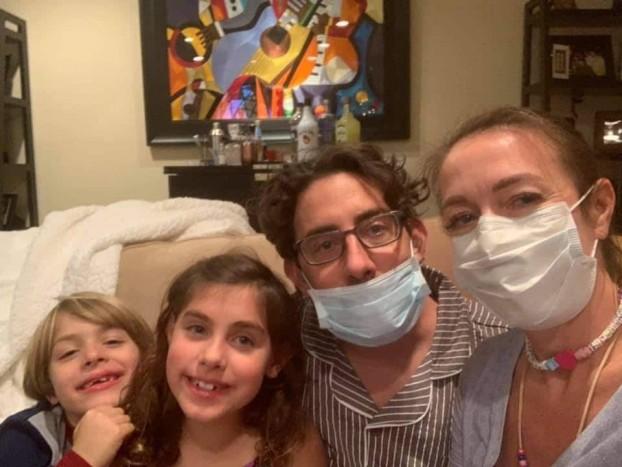 family wearing mask at home during corona pandemic
