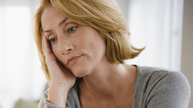 sad and tired matured woman