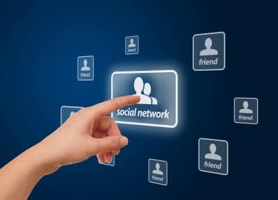 woman finger-pressing the social network icon
