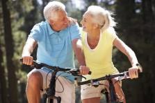 happy matured couple biking