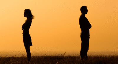 Couple standing apart, never satisfied in relationship
