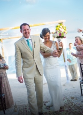 couple walking down the aisle as newly-weds