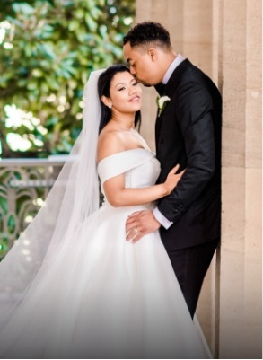 groom kissing her bride on the forehead