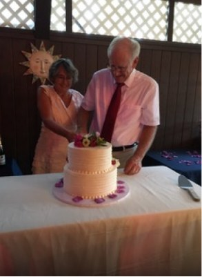 older couple slicing their wedding cake