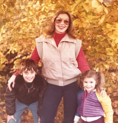 cool mom wearing sunglasses with her kids