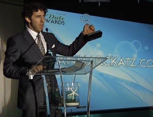 Evan Marc Katz receiving an award