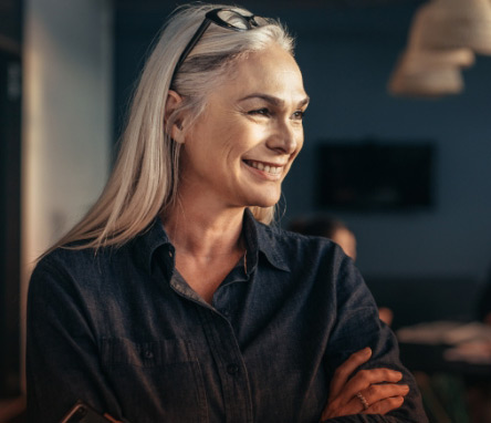 strong successful woman with gray hair smiling
