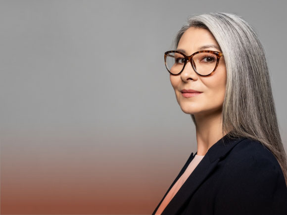 a business woman with long hair, wearing eyeglasses