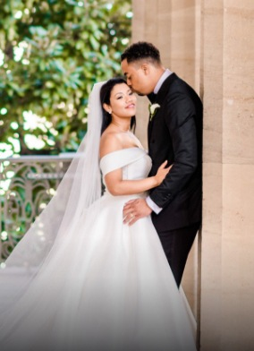 groom giving her bride a kiss on the forehead - love u success story