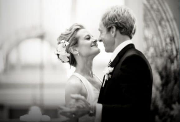 Love U success story of happily married couple gazing at each other while dancing waltz