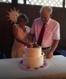 Love U success story of older newly married couple slicing a cake