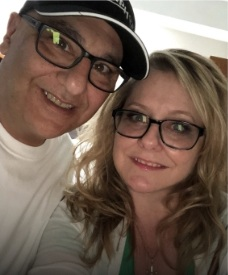 happy smiling blonde woman successfully found love online through Love U by Evan Marc Katz