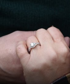 Love U success story of a newly engaged couple showing engagement ring