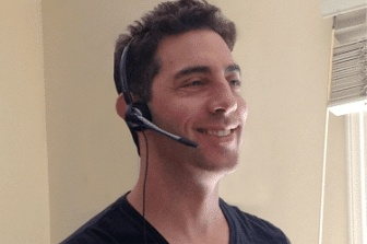 Evan Marc Katz on his headphone, smiling