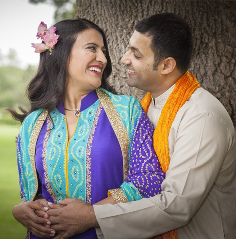 Love U love story of successful woman with a flower on her right ear smiling to husband