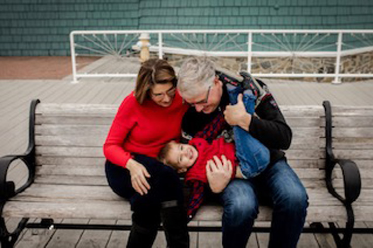 couple playing with their toddler boy