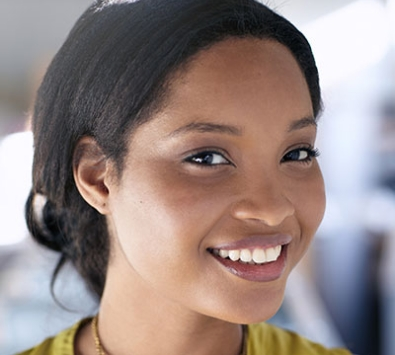 Smart strong successful woman with black hair smiling