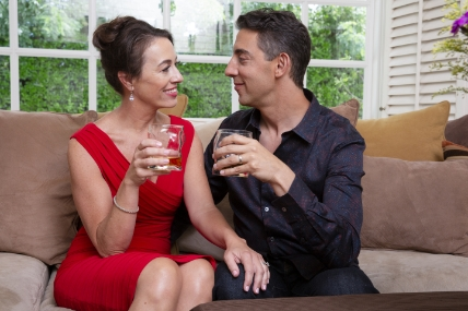 Evan Marc Katz and wife sitting on sofa gazing at each other