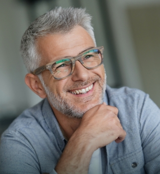 older man wearing glasses and smiling