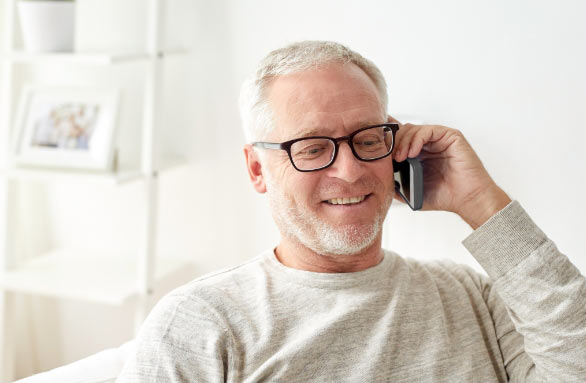 an older man wearing eyeglasses talking on his phone