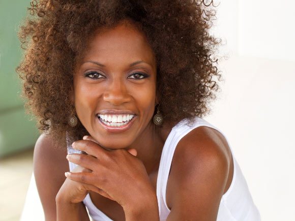 colored woman with curly, bouncy hair
