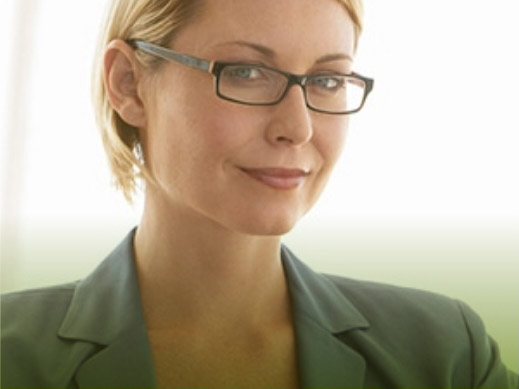 smart, independent woman wearing formal attire with eyeglasses