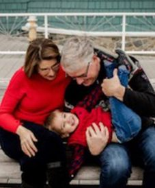 Love U success story of a strong smart successful woman with her handsome husband and little son wearing a red jacket