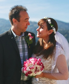 Love U success story of a newly married woman holding white and pink flowers with her older husband