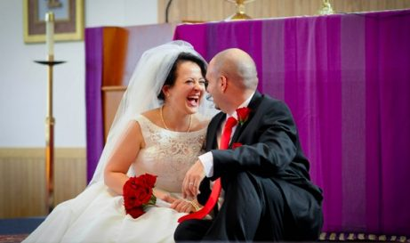 Love U success story of a newly married couple laughing together in the church