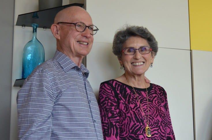 lovely older couple wearing glasses