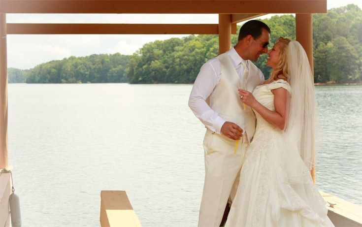 happy newly married couple at the lake house