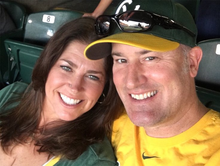 middle-aged couple watching a sports event