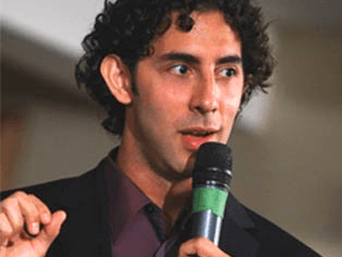 young Evan Marc Katz speaking on an event