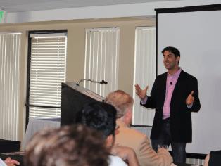 enthusiastic Evan Marc Katz while delivering a speech