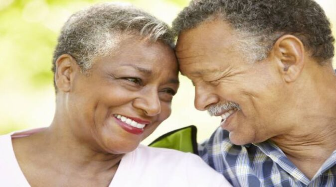 Senior couple with a happier marriage smiling at each other.