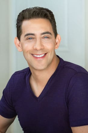 Dating Coach Evan Marc Katz wearing a purple shirt.