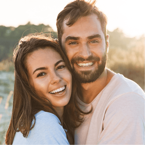 Love U success story of young beautiful couple smiling and being romantic at sunset