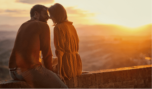 romantic couple watching sunset