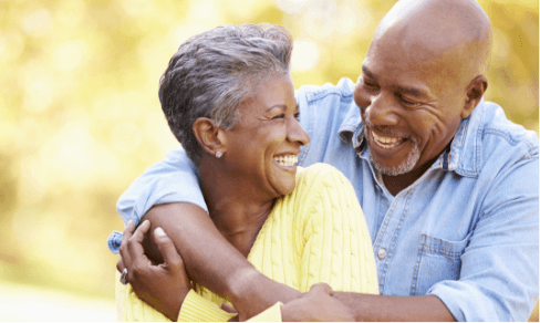 Love u success story of older couple hugging and laughing each other