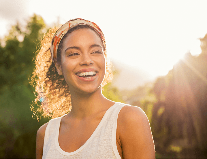 smart strong successful woman with curly hair smiling