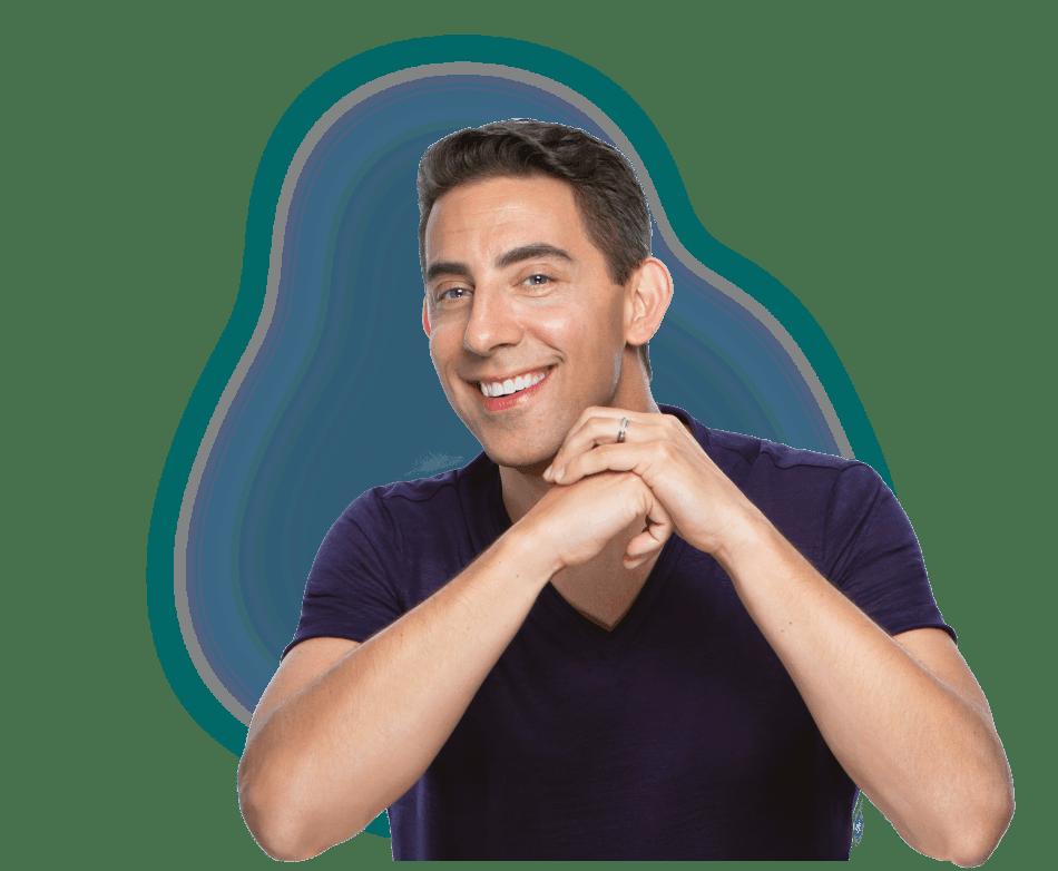 dating coach Evan Marc Katz wearing a purple t-shirt smiling