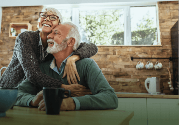 Love u success story of older couple happily cuddling hugging each other