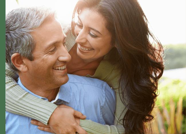 woman giving her husband a hug - love u success story