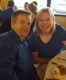matching couple in royal blue eating together