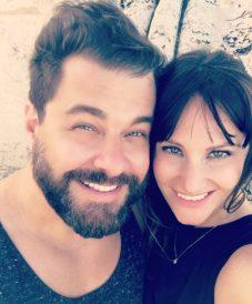 bearded man cheek-to-cheek with his girl