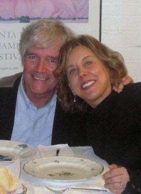 an elder couple having dinner together