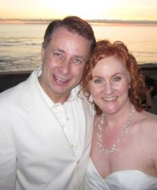 newly-wed middle-aged couple enjoying the beach scene