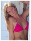 A blonde woman in a sexy pink bikini top.